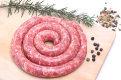Raw sausage on wooden cutting board Royalty Free Stock Photos