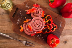 Raw sausage on wooden table. Royalty Free Stock Photography