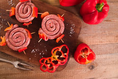 Raw sausage on wooden table. Stock Image