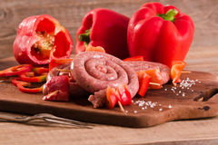 Raw sausage on wooden table. Stock Photo