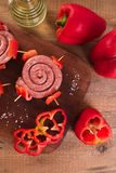 Raw sausage on wooden table. Royalty Free Stock Image