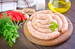 Raw sausages. With aroma spices Stock Image