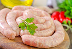 Raw sausages. With aroma spices Stock Images