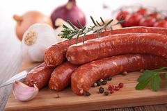 Raw sausages on board Stock Photography