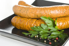Raw sausages close up. Spiced Raw sausages close up stock photo