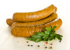 Raw sausages close up. Spiced Raw sausages close up stock images
