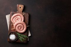 Raw sausages. Cooking on wooden cutting board. Top view with space for your text Royalty Free Stock Photos
