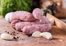 Raw Sausages. With garlig and spices on the cutting board Stock Photo