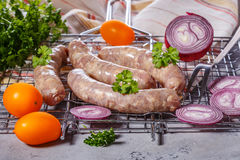 Raw sausages on the grill grate. Stock Image
