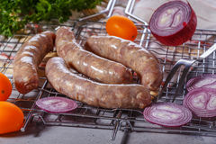 Raw sausages on the grill grate. Stock Images