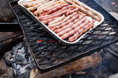 Raw sausages grilling Royalty Free Stock Image