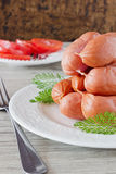Raw sausages for grilling. On a plate on wooden background close-up. meat products.  selective focus Stock Image