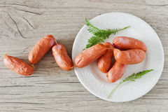 Raw sausages for grilling. On a wooden background. top view. meat products Royalty Free Stock Image
