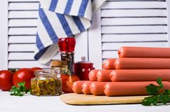 Raw sausages in peel Royalty Free Stock Photo