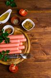 Raw sausages in peel Stock Photography