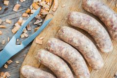 Raw sausages ready for grill. Selective focus stock photography