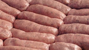 Raw Sausages Rotating. Closeup of sausages turning slowly stock footage