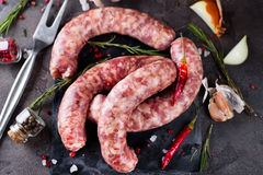Raw sausages on slate Royalty Free Stock Image