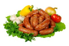 Raw sausages and vegetables royalty free stock photography