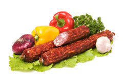 Raw sausages and vegetables royalty free stock photo