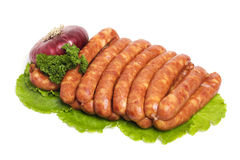 Raw sausages and vegetables royalty free stock image