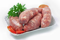 Raw sausages. On white background Stock Photography