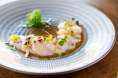 Raw scallops sashimi seafood dish. Fresh raw scallops sashimi dish. Sashimi is a Japanese cuisine delicacy consisting of sliced raw meat usually fish and Royalty Free Stock Images