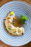 Raw scallops top view. Fresh raw scallops sashimi dish. Sashimi is a Japanese cuisine delicacy consisting of sliced raw meat usually fish and seafood often Royalty Free Stock Photos