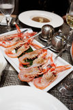 Raw scampi dish on restaurant table Stock Photos