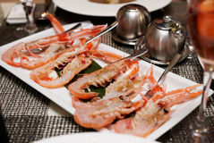 Raw scampi dish on restaurant table. Tasty seafood Stock Photography