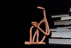 Raw sculpture of reading person Stock Photos