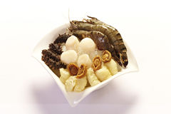 Raw Seafood in bowl. Raw Sea Cucumber ,scallop,abalone and prawn on ice in a bowl Royalty Free Stock Photography