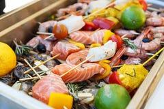 Raw seafood kebabs stock image