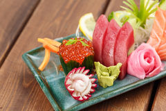 Raw Seafood selections. Fresh seafood selection on the plate with wasabi and ginger Royalty Free Stock Photo