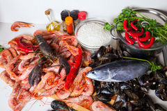 Raw seafoods and fish ready for cooking Stock Photo