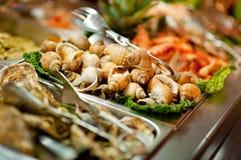 Raw seashells on buffet Royalty Free Stock Image