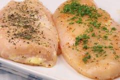 Raw seasoned chicken breast royalty free stock photography