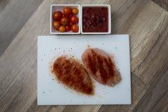 Raw, seasoned chicken breast Stock Photo