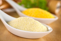 Raw Semolina. With ground corn in the back (Selective Focus, Focus one third into the semolina Royalty Free Stock Photo