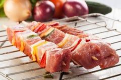 Raw shashlik on grill Stock Photos