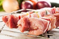 Raw shashlik on grill Royalty Free Stock Image