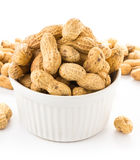 Raw shelled great peanuts in a bowl on white background, closeup Stock Image