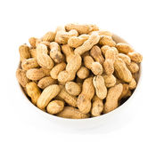 Raw shelled peanuts in a bowl on white background, closeup Stock Images