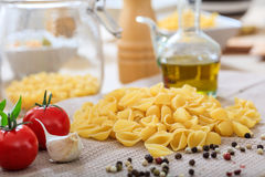 Raw shells pasta with vegetables. And olive oil Royalty Free Stock Images