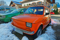 Raw of shiny cars of bright colors parked in the street of Garmi Stock Photography
