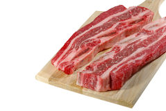 Raw short ribs on a cutting board Royalty Free Stock Photo