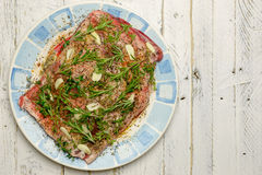 Raw Shoulder of Lamb Meat in Olive Oil Marinade on Plate With Bl Stock Photo