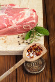 Raw shoulder lamb on wooden board and table. With 1lb iron weight royalty free stock image