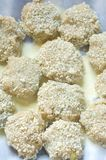 Raw Shrimp Cakes. A platter of panko covered raw shrimp cakes waiting to be cooked Stock Photography