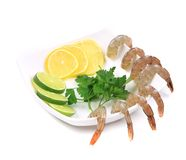 Raw shrimp with lemon limes and parsley Stock Image
